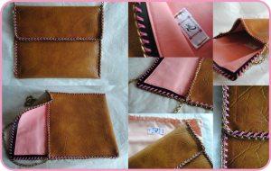 Clutch en piel marrón con detalles rosa chicle.