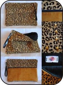 Clutch de piel con print de leopardo y tachuelas doradas.